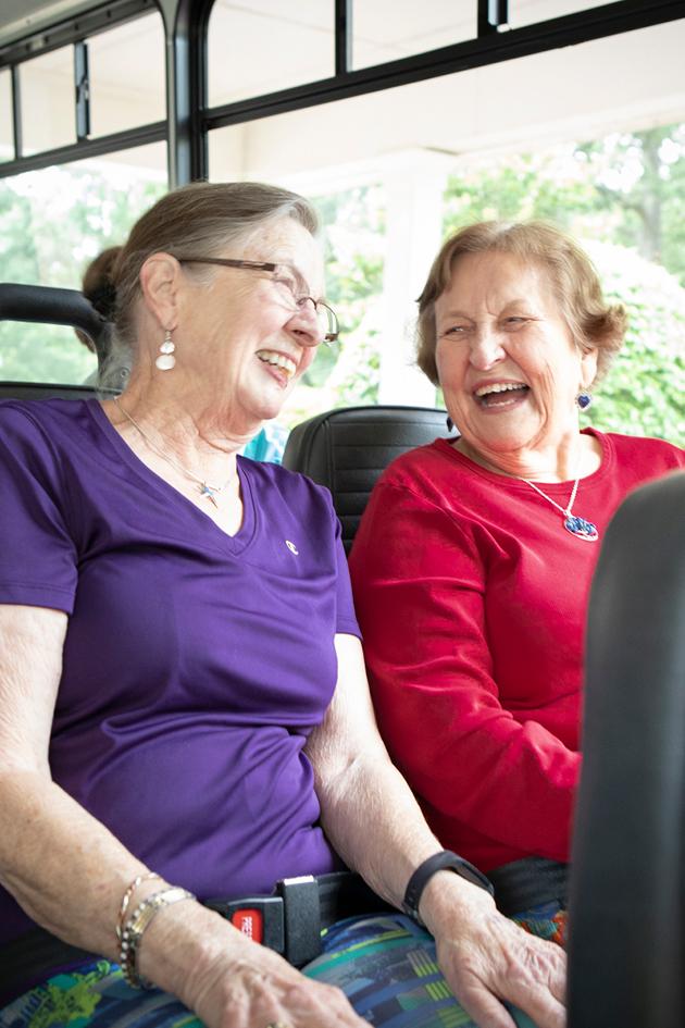 women smiling on bus